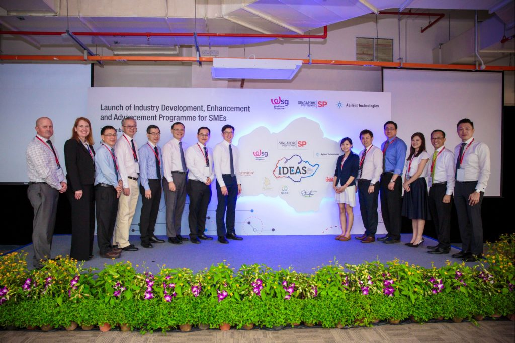 icube events_ideas launch 2016 guests group photo with completed backdrop after launch