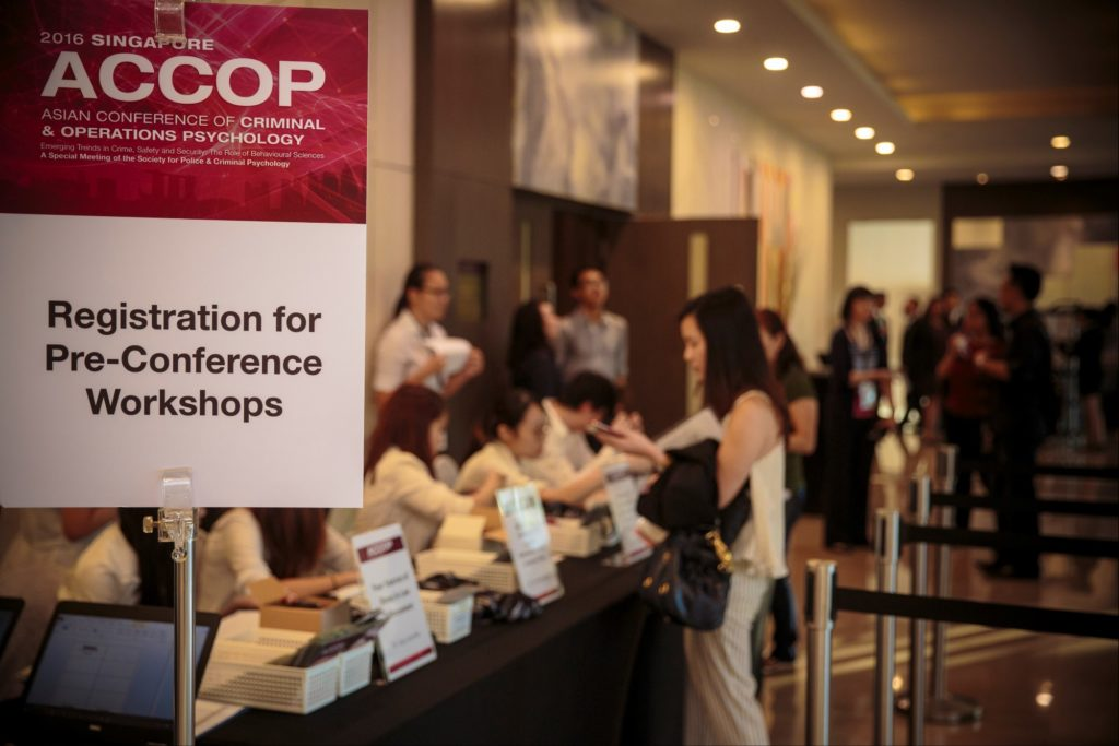 icube events_accop 2016 registration counter with customised directional signage with event branding