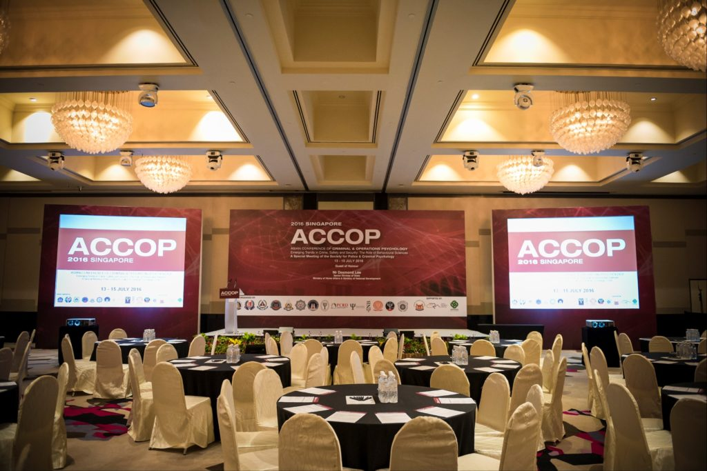 icube events_accop 2016 main conference backdrop with screen projectors and half cluster table setting