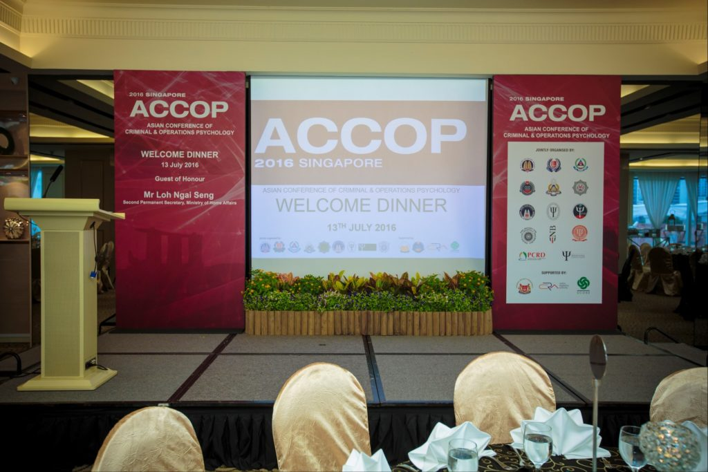 icube events_accop 2016 welcome dinner stage with projector screen and flanking backdrops and landscaping