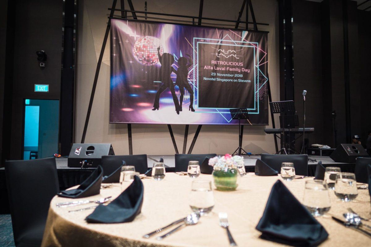 icube events_alfa laval family day 2018 stage backdrop with round table setting