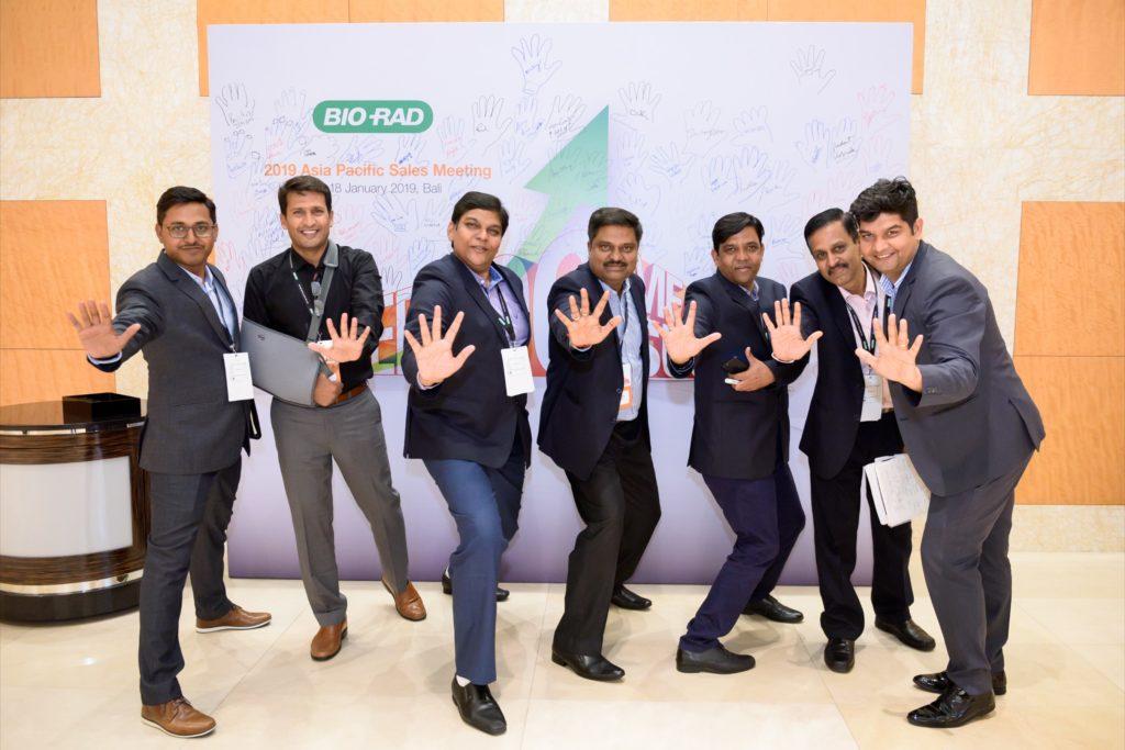 icube events_bio rad asia pacific sales meeting participants hi five pose