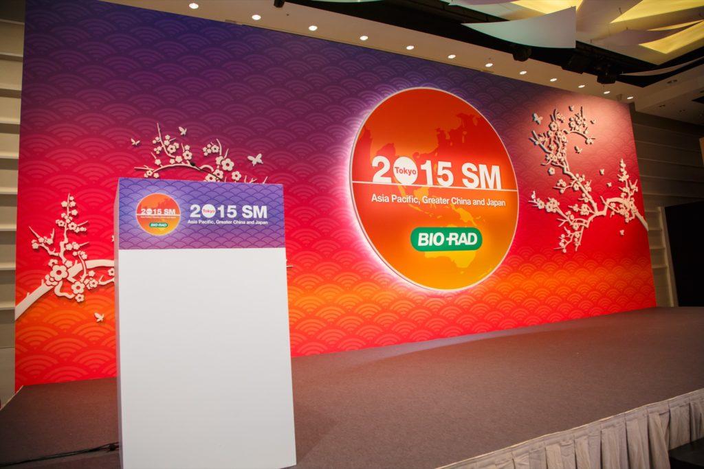 Full-length customised backdrop with LED backlit logo and customised podium wrap